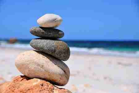 pile of stones on a beach - writing a story is an act of balance